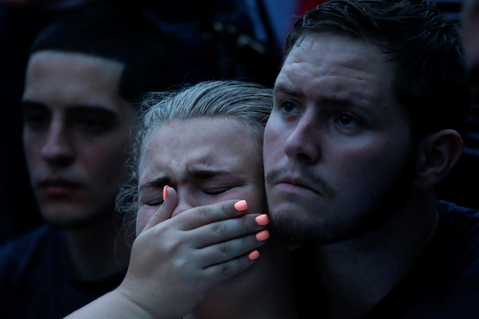 Savannah (L) is embraced by her friend Ricky during a vigil to commemorate victims of a mass shooting at the Pulse gay night