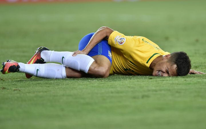 Brazil's Philippe Coutinho gestures on the ground during the Copa America Centenario football tournament match against Peru.