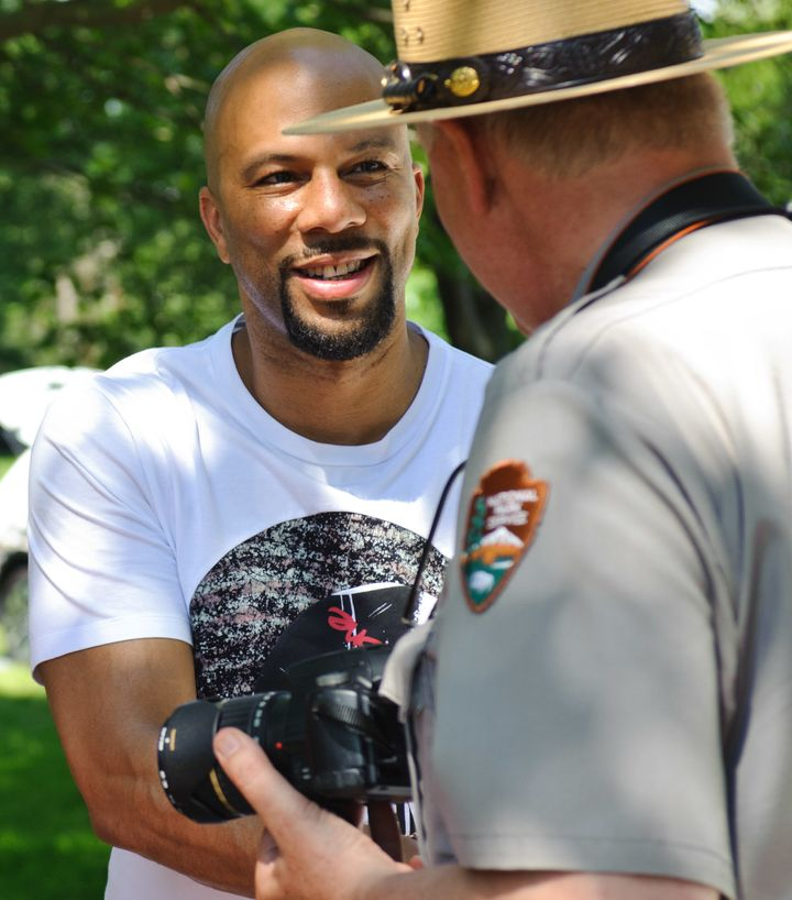 Common serves as Honorary Grand Marshal at the National Park Service Centennial Event at Washington Park on June 11, 2016 in