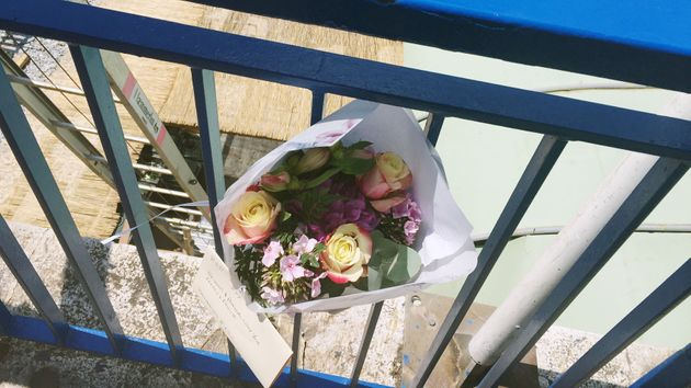Flowers are left close to the scene where Rodgers died after a