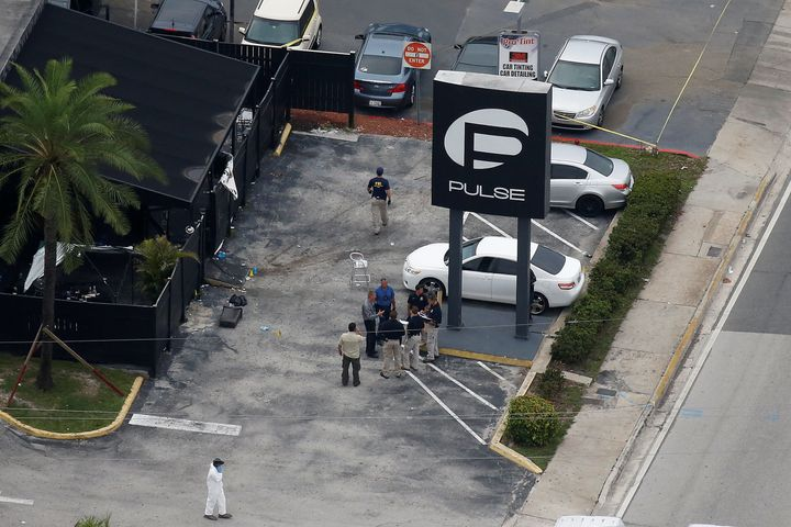 Investigators work the scene following a mass shooting at Pulse, a gay nightclub in Orlando, Florida, on June 12. ISIS claime