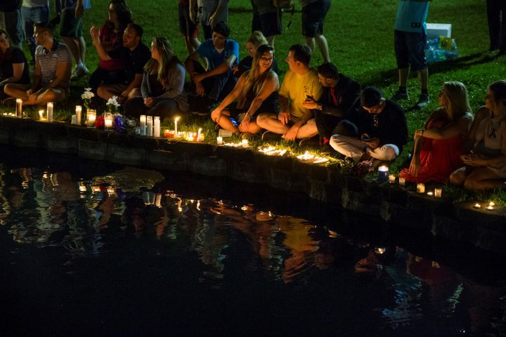 Mourners gather at Lake Eola in Orlando for a candle light vigil for the victims of the terrorist massacre at the gay night c