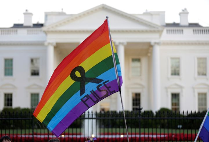 A rainbow flag is seen waving before the White House with the name of the gay nightclub where a gunman, who was fatally shot