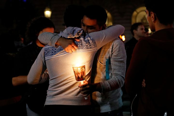 Two San Francisco men hug at a vigil for the victim's of the Orlando shooting.