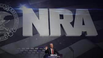 Donald Trump, presumptive Republican presidential nominee, speaks during the National Rifle Association (NRA) annual meeting in Louisville, Kentucky, U.S., on Friday, May 20, 2016. Trump, who in the past called for restrictions on certain weapons purchases, announced his a plan in September for a national right-to-carry law and called gun and magazine bans 'a total failure.' Photographer: Luke Sharrett/Bloomberg via Getty Images