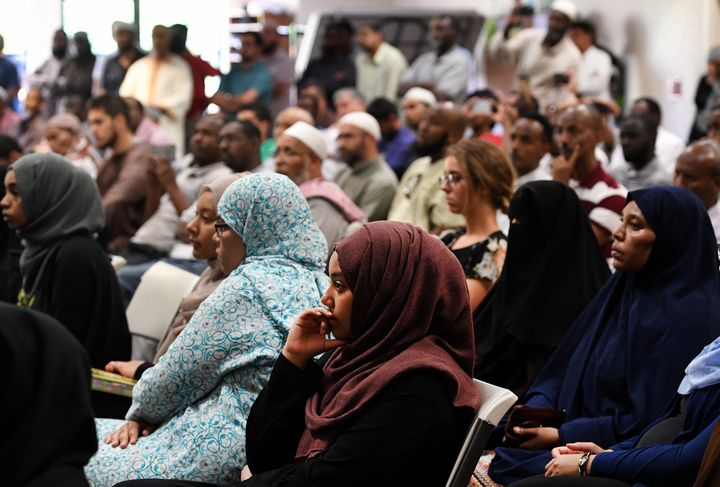 Ebtesam Mohammed, middle, and other young women listen and reflect during a press conference at the Colorado Muslim Society i