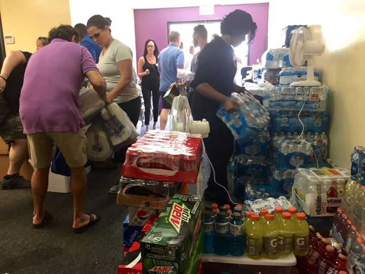 Volunteers at the LGBT Center of Central Florida stack food and water pouring in from locals and area businesses. Theco