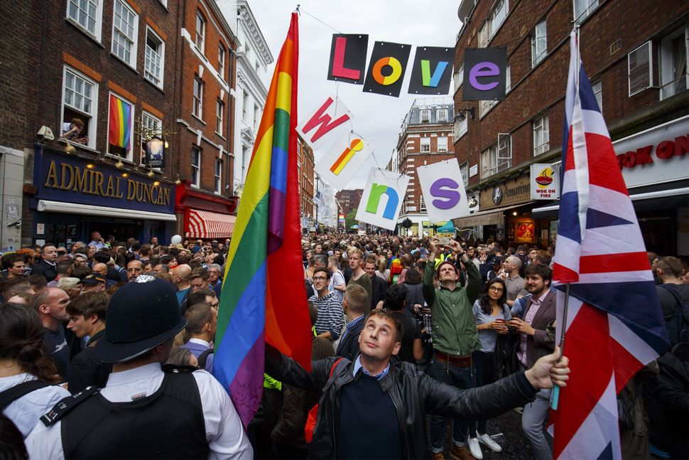 LGBT members and alliesmarchoutside the Admiral Duncan pub on Old Compton Street.