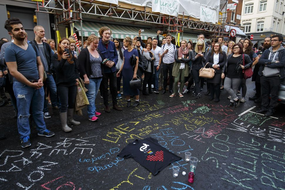 Mourners gatheroutside the Admiral Duncan pub on Old Compton Street.