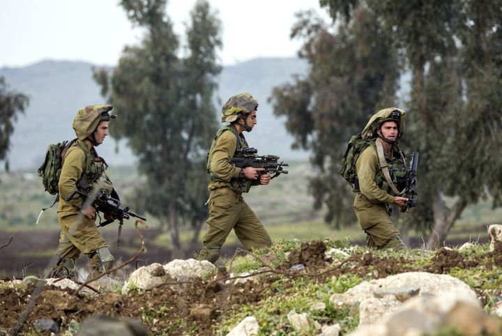 In Israel, the soldiers are heavily armed, but civilians have to clear several tests before they can legally purchase a