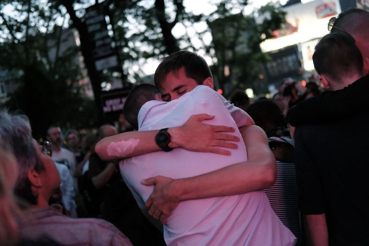 Mourners gather outside of the iconic New York City gay and lesbian bar The Stonewall Inn to light candles,lay flowers and gr