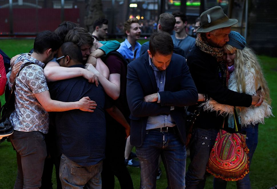 Mourners embrace during a vigil in memory of the victims of the gay nightclub mass shooting in Orlando. They gathered at St A