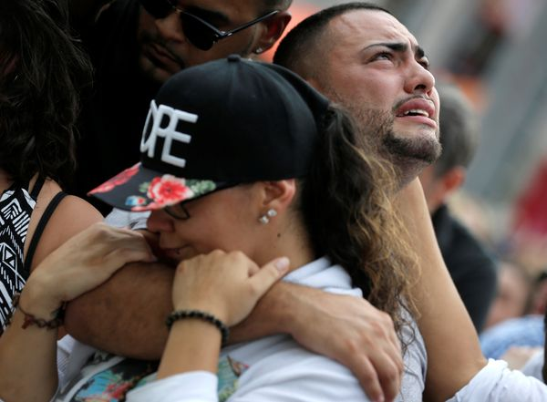 Mourners grieve at a vigil for the victims of the shooting at the Pulse gay nightclub in Orlando, Florida.