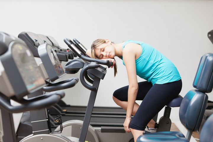 Young woman resting on the exercise machine. Mie Ahmt via Getty Images