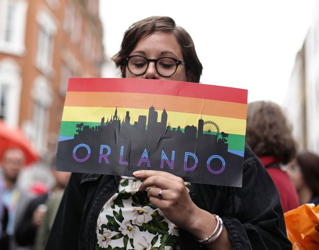 A woman holding an Orlando placard on Old Compton Street, London, during a vigil for the