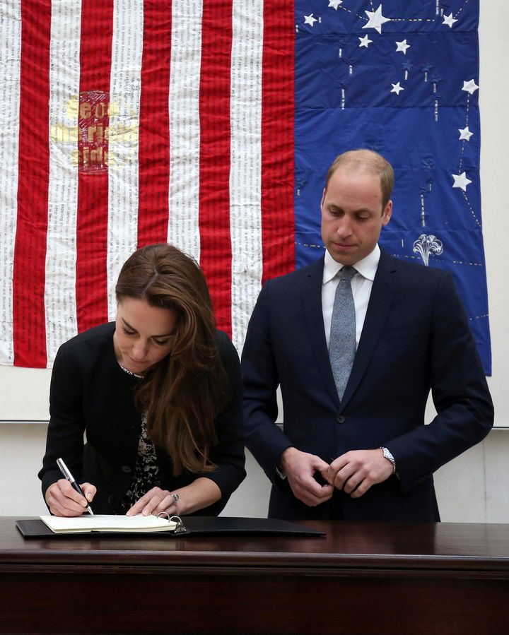 Will and Kate write a message of condolences at the U.S. Embassy in London.