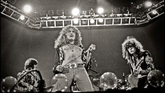 LONDON - 24th MAY: John Paul Jones, Robert Plant and Jimmy Page from rock group Led Zeppelin perform live on stage at Earls Court in London on 24th May 1975. (Photo by Dick Barnatt/Redferns)