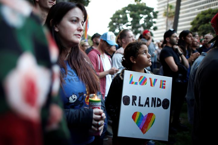 People attend a vigil being held in Los Angeles on Monday for the victims a mass shooting at the Pulse gay nightclub in Orlan