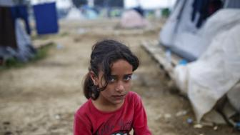 A child looks on at a makeshift camp for migrants and refugees at the Greek-Macedonian border near the village of Idomeni, Greece, April 3, 2016. REUTERS/Marko Djurica