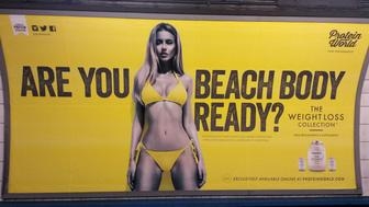 """A Protein World advert displayed in an underground station in London which says """"Are you beach body ready?"""" as a petition calling for its removal gathers tens of thousands of signatures."""