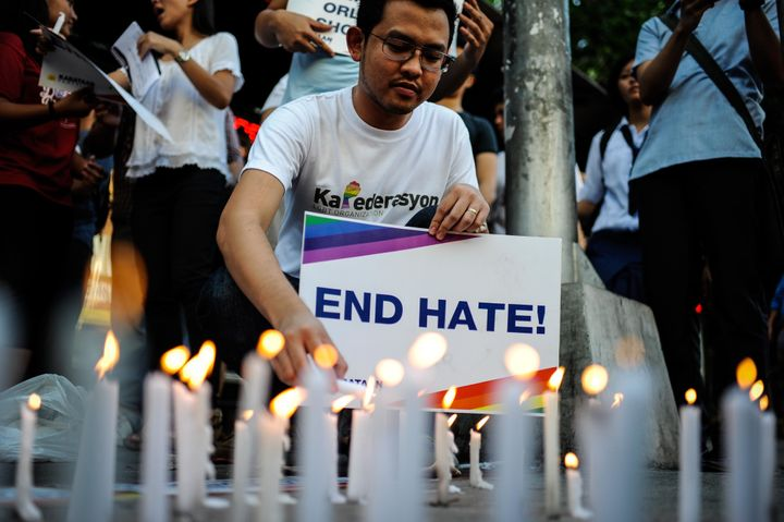 Candles are seen being lit during a vigil that was held for the victims in Manila, Philippines, on Tuesday.