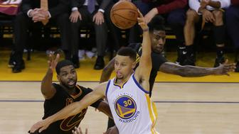 June 13, 2016; Oakland, CA, USA; Golden State Warriors guard Stephen Curry (30) controls the ball against Cleveland Cavaliers center Tristan Thompson (13) and guard Iman Shumpert (4) during the second half in game five of the NBA Finals at Oracle Arena. Mandatory Credit: Kelley L Cox-USA TODAY Sports