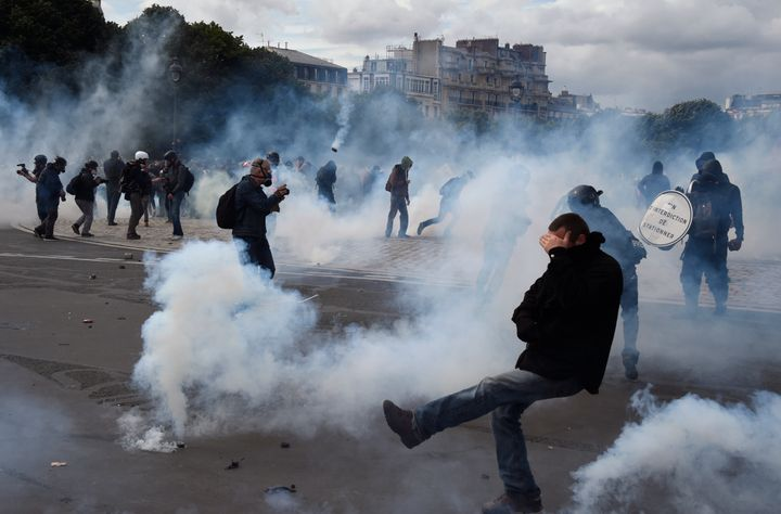 Police say they fired dozens of volleys of teargas and used water cannon against gangs of maskedyouths at a protest aga
