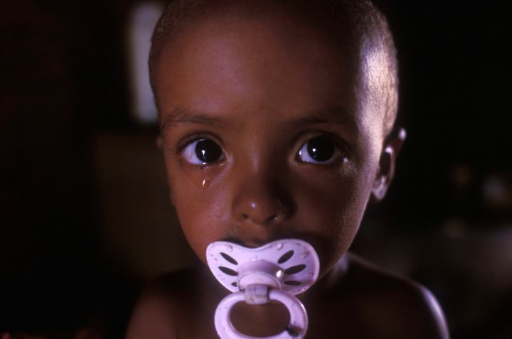 Infant malnutrition, portrait of two-years old half-breed boy crying and looking directly at camera, Pernambuco State, Northe
