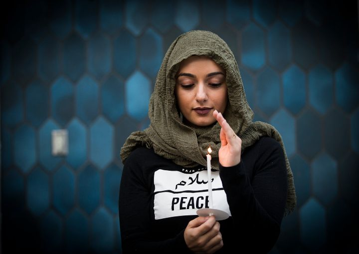 Marwa Balkar holds a candle at the Islamic Center of Southern California and ICUJP Interfaith Vigil Against Violence and Hatr