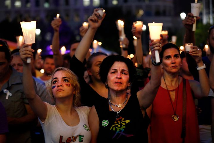 Madeline Lago, 15, and her mother Carmen Lago (center) were among the thousands who gathered for a memorial rally in downtown