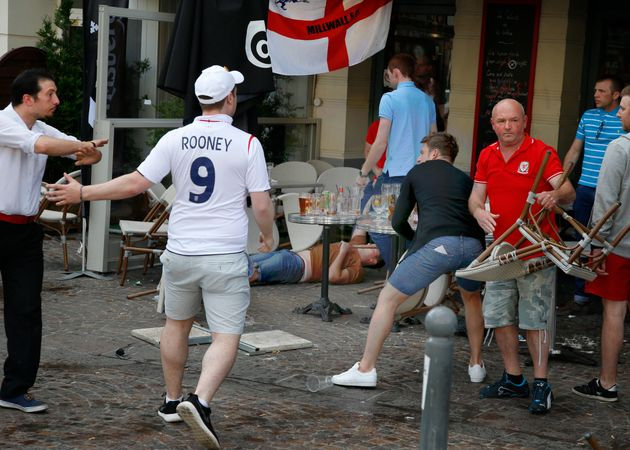 England and Wales fans react after scuffles with Russian supporters outside a barin