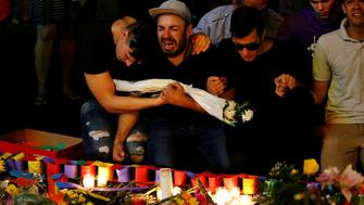 A man sits and cries after taking part in a candlelight memorial service the day after a mass shooting at the Pulse gay nightclub in Orlando, Florida, U.S. June 13, 2016. REUTERS/Carlo Allegri     TPX IMAGES OF THE DAY