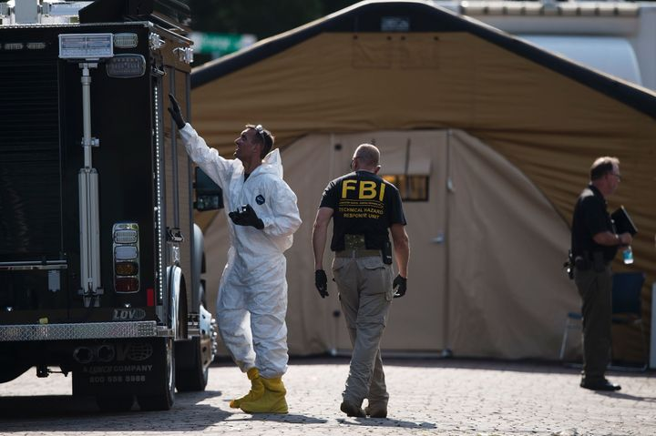 Members of the FBI and other investigators work in the area around Pulse nightclub on June 13 in Orlando, Florida.