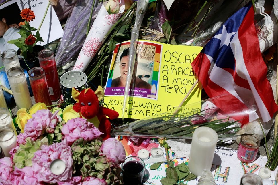 A Puerto Rican flag and tributes and to the victims at the Stonewall memorial.