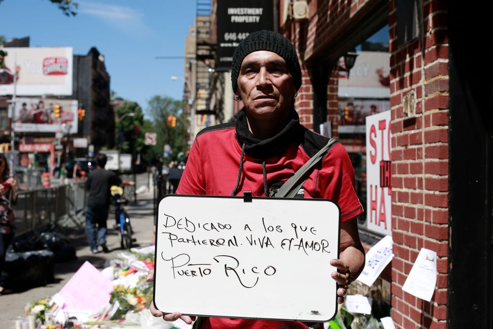 "Puerto Rican Alejandro Cruz wrote his message in Spanish: ""Dedicated to those who passed. Long live love. Puerto Rico"""