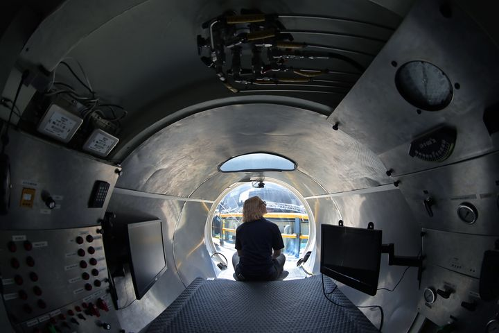 Submarine pilot-in-training Isabel Johnson sits at the bow of the Cyclops 1, a five-person sub used to capture deta