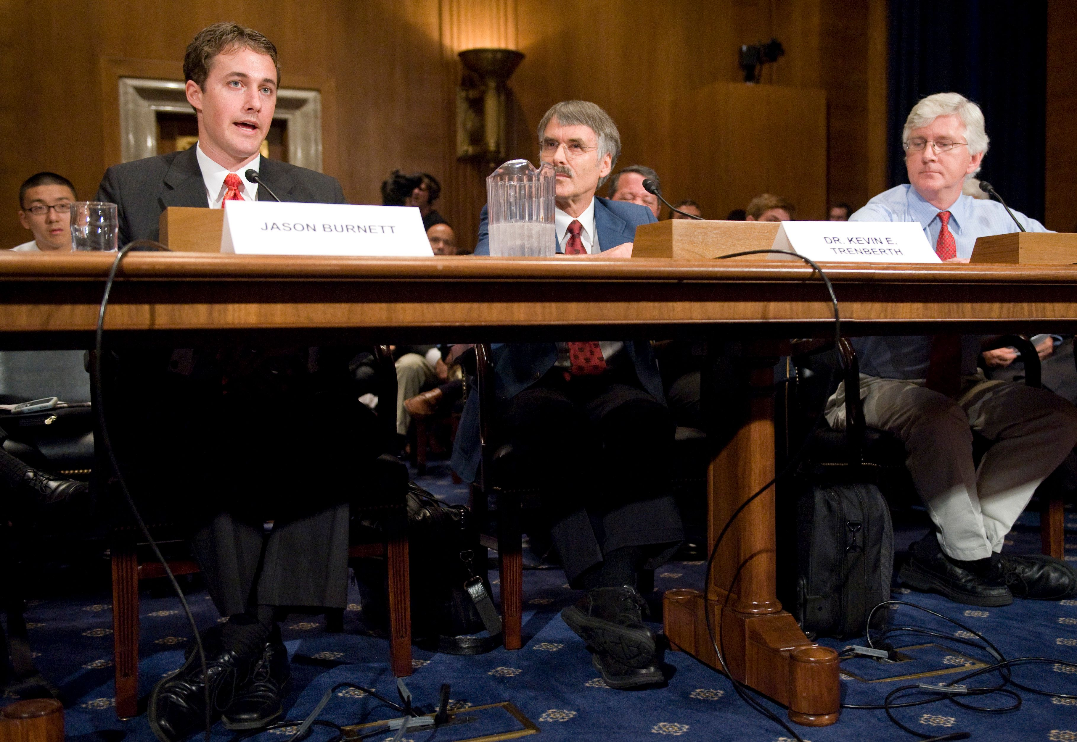 UNITED STATES - JULY 22:  From left, former Associate Deputy EPA Administrator Jason Burnett, Kevin Trenberth, head of the climate analysis section at the National Center for Atmospheric Research, Climate and Global Dynamics Division, and Roy Spencer, principal research scientist in the Earth System Science Center at the University of Alabama in Huntsville, testify during the Senate Environment and Public Works Committee hearing on 'An Update on the Science of Global Warming and its Implications,' on Tuesday, July 22, 2008. The hearing touched on allegations that the White House suppressed testimony and other findings regarding global warming.  (Photo By Bill Clark/Roll Call/Getty Images)