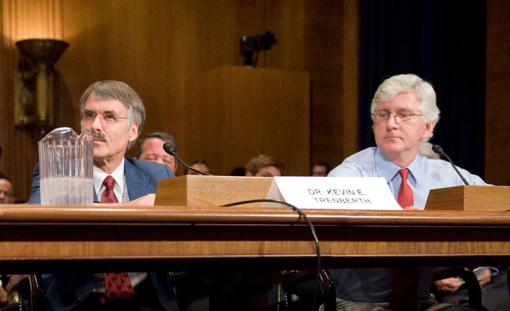 Roy Spencer, right, testifies beforeaSenate hearing on global warming on July 22, 2008.