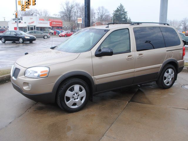 The family may be driving a vehicle similar to this gold 2006 Pontiac Montana. The Idaho plate reads: 2CJN683