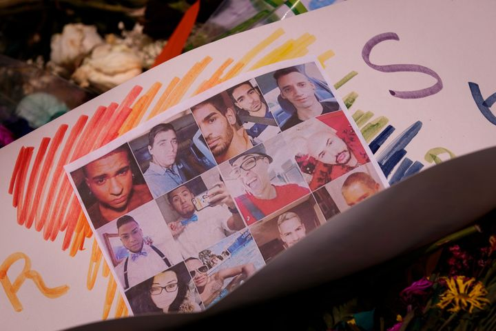 ORLANDO, FL - JUNE 14: Flowers and photographs for the victims of the Pulse Nightclub shooting lay at a makeshift memorial, J