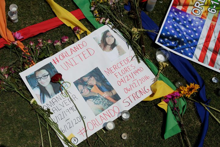 Flowers and messages for the victims of the Pulse Nightclub shooting lay at a makeshift memorial.