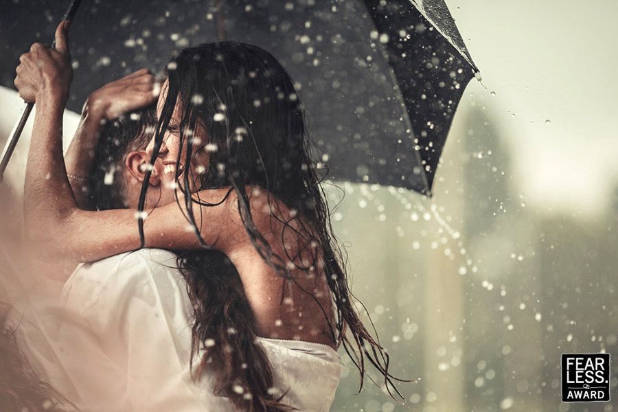 """They may be soaked to the skin, but this pair is clearly embracing the downpour and loving their time together. The photogra"