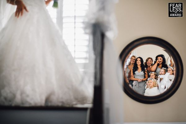 """""""The reflection in the mirror is so perfectly framed as a group portrait that you might have found yourself scanning the figu"""