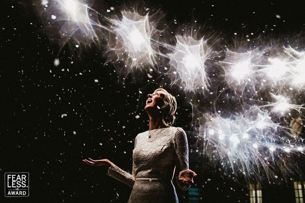 """""""The bride's happy amazement at the snowfall looks so genuine and unrestrained that we can almost feel the snowflakes falling"""