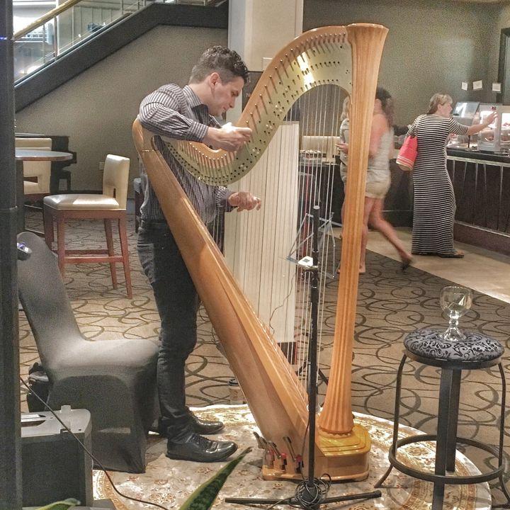 "<a href=""http://www.matthewtutsky.com/"">Matthew Tutsky</a> preps his harp to accompany the Riverside's killer brunch.The harp pairs well with bottomless mimosas."