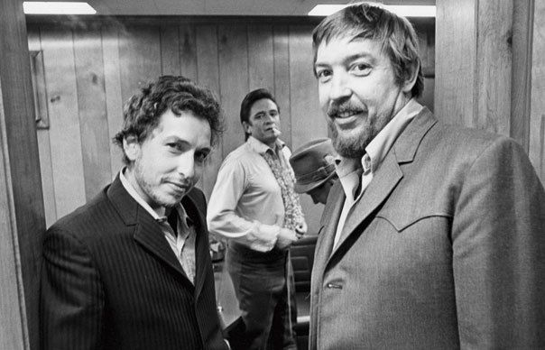 Dylan with Johnny Cash and producer Bob Johnston in 1969.