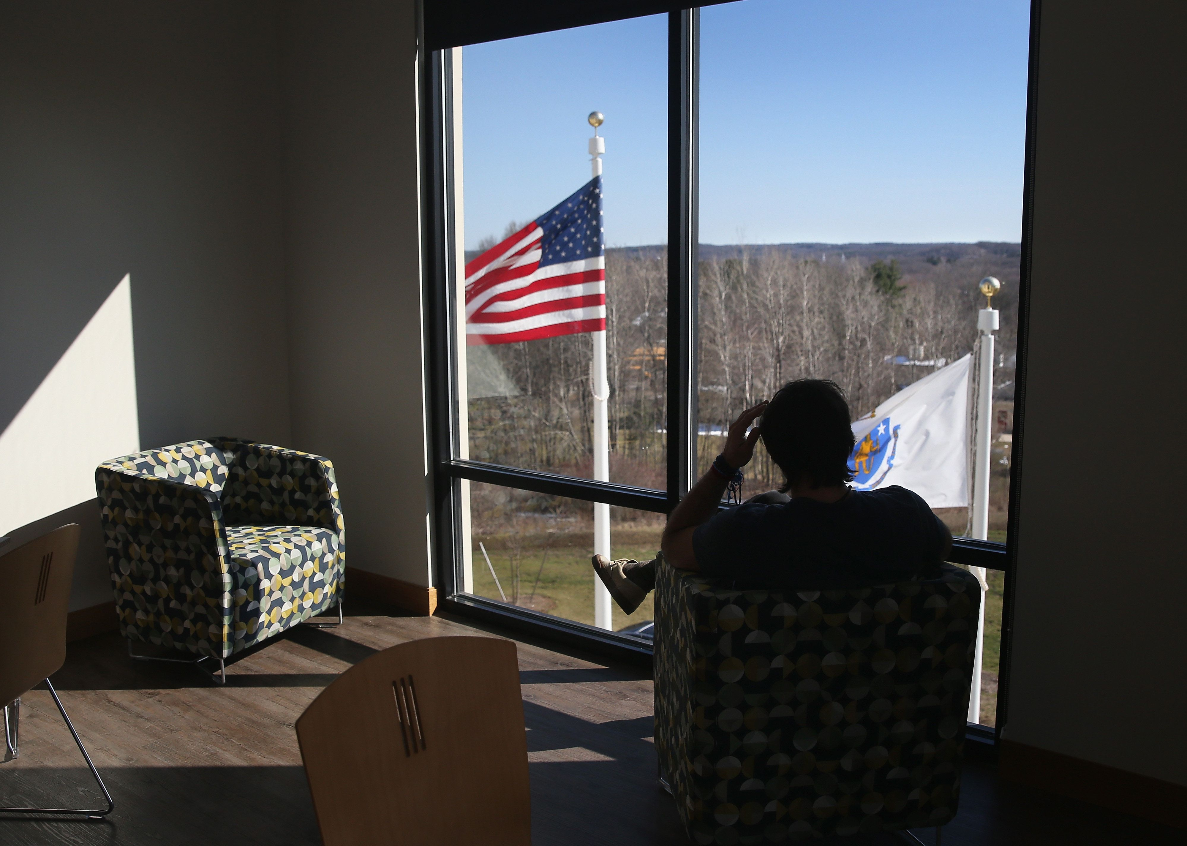 WESTBOROUGH, MA - MARCH 22:  A drug addict in recovery looks out from a substance abuse treatment center on March 22, 2016 in Westborough, MA. The new 100-bed residential rehab center, run by Spectrum Health Systems, is expanding staff, as communities across New England are struggling with the unprecidented heroin and opioid pain pill epidemic. On March 15, the U.S. Centers for Disease Control (CDC), announced guidelines for doctors to reduce the amount of opioid painkillers prescribed nationwide, in an effort to curb the epidemic. The CDC estimates that most new heroin addicts first became hooked on prescription pain medication before graduating to heroin, which is stronger and cheaper.  (Photo by John Moore/Getty Images)