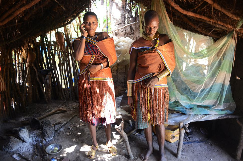 Udenda Gidaghorjod, 20, and her mother, Wembida, 40, in traditional Barabaig dress at home.<i></i>