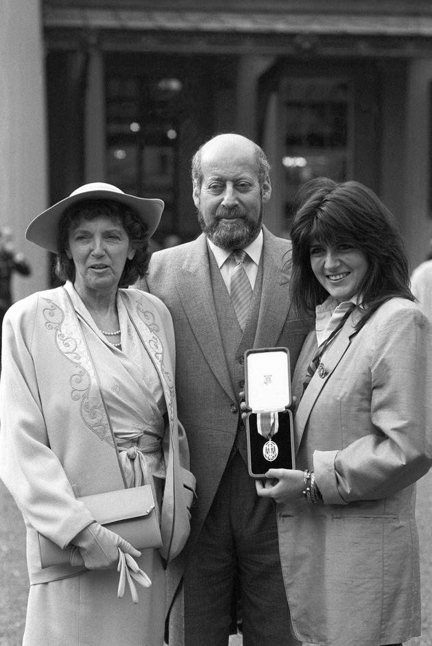 Sir Clement Freud with his wife Jill (left) and daughter Emma after receiving his knighthood at Buckingham...