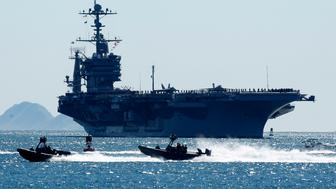 The nuclear powered aircraft carrier USS John C. Stennis (CVN74) sails into San Diego harbor, February 10, 2011. The Bremerton Washington based ship will participate in a Centennial of Naval Aviation celebration during the visit.   REUTERS/Mike Blake  (UNITED STATES - Tags: MILITARY POLITICS)